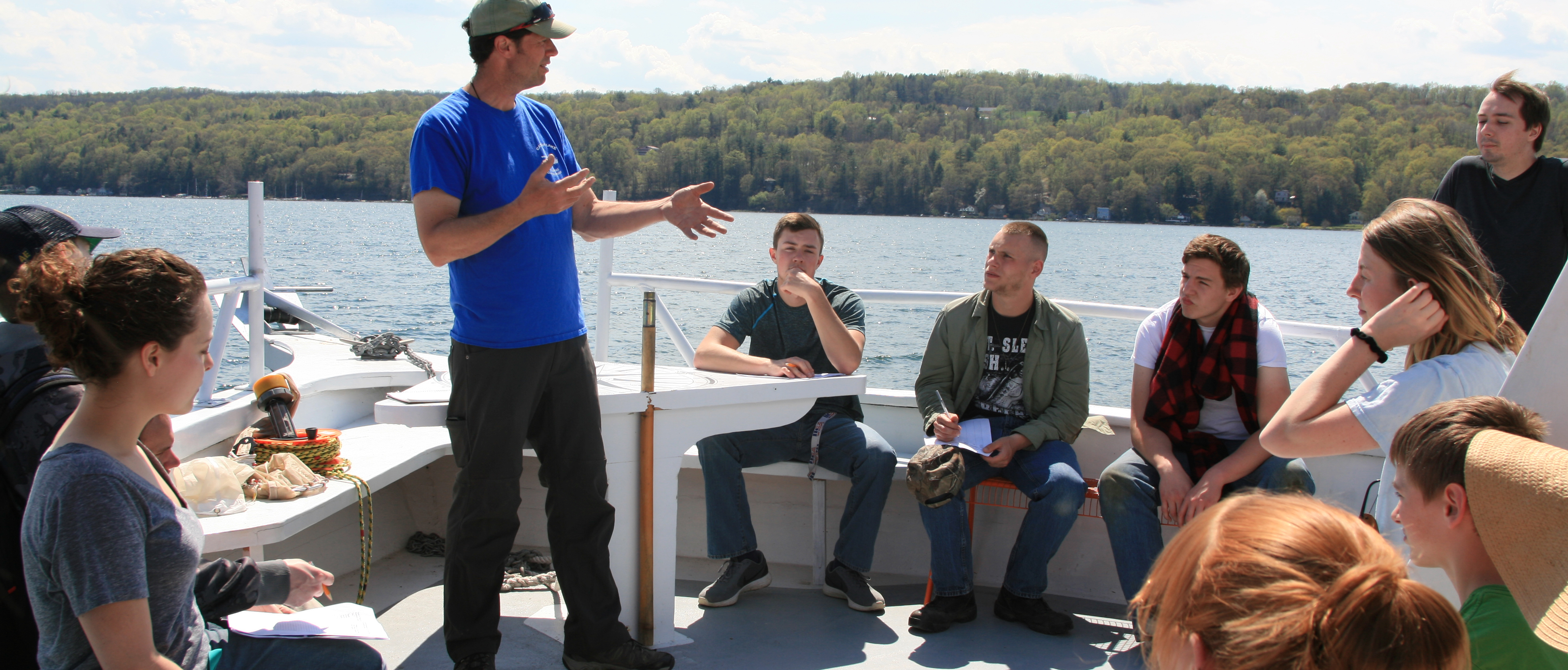 Instructor talking to students on boat
