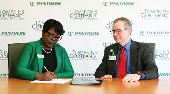 Tompkins Cortland President Orinthia Montague and CRMC President and CEO Mark Webster sign agreement