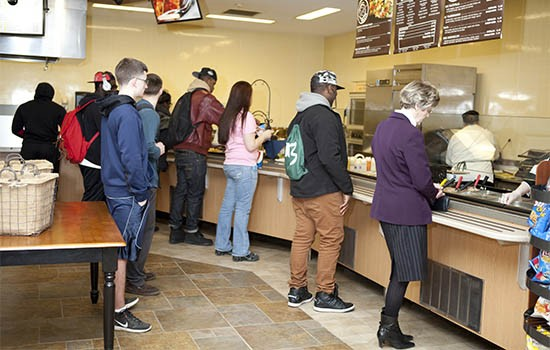 Students standing in line in dining hall