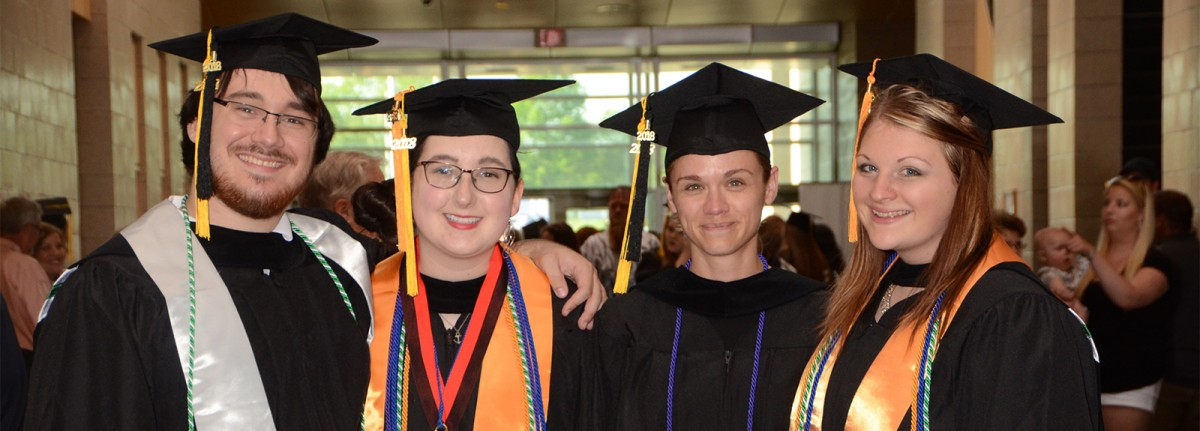 Four students at Commencement