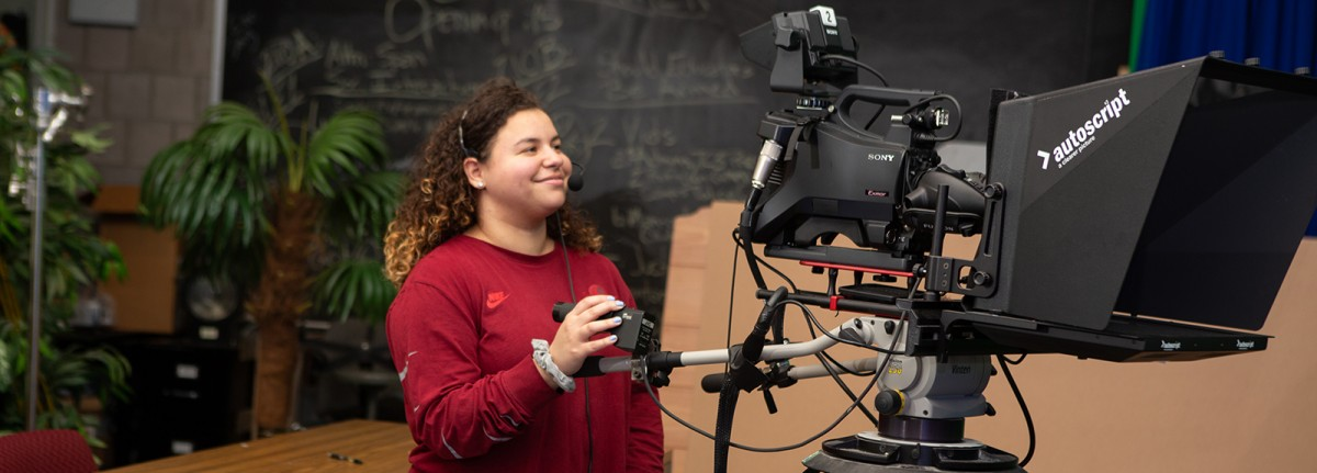 Student filming in Media Class