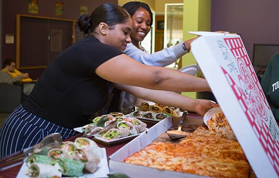 Students getting pizza in the student center