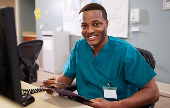 Clinical Medical Assistant at the computer