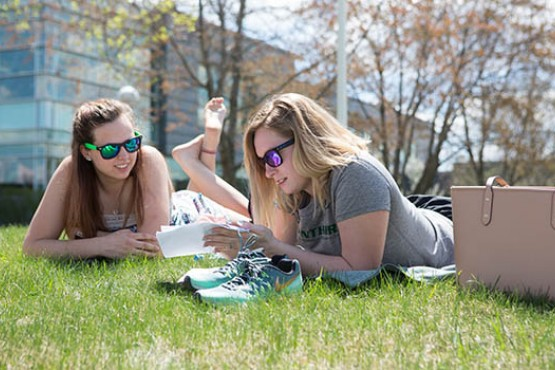 Students studying outside of Dryden Campus