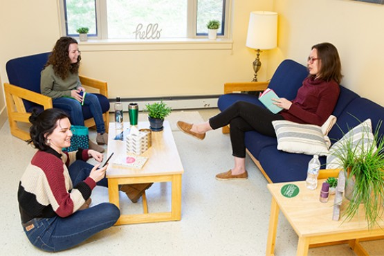 Students talking in on campus dorm living room